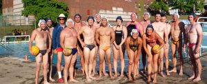 Water polo players at edge of Ammon Swim Pool